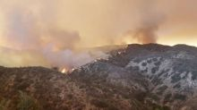 California wildfire said set by arsonist threatens community