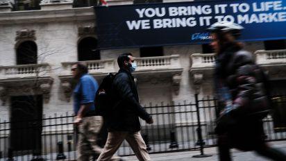 Stocks jump, Nasdaq powers to record high as investors look past virus concerns
