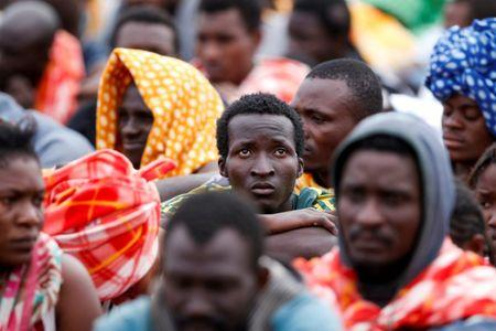 FILE PHOTO: Migrants disembark from a vessel of ONG Medecins sans Frontieres (MSF) in the Sicilian harbour of Augusta