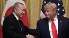 Trump gives Turkish president a warm welcome despite lawmakers' dissent