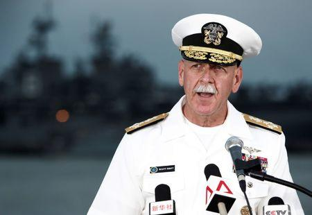 Admiral Scott Swift, Commander of the U.S. Pacific Fleet, speaks at a news conference near the damaged USS John McCain and the USS America at Changi Naval Base in Singapore