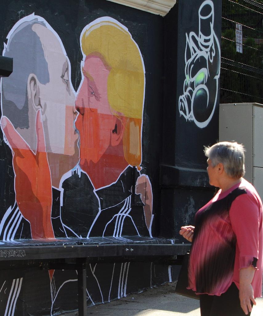 In 2016, artists in Vilnius painted a mural depicting Putin and Trump kissing (AFP Photo/Petras Malukas)