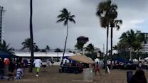 Waterspout sends bounce house into sky with kids inside