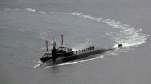 Reports of North Korea artillery drill as U.S. submarine makes South Korea port call