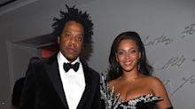 Jay-Z and Beyoncé sit during national anthem at Super Bowl