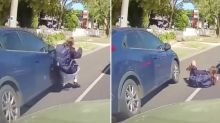 Shocking moment schoolgirl is hit by car crossing busy street – but who's at fault
