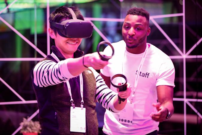 An attendee tries out the new Oculus Quest Virtual Reality (VR) gaming system at the Facebook F8 Conference at McEnery Convention Center in San Jose, California, on April 30, 2019. - Got a crush on another Facebook user? The social network will help you connect, as part of a revamp unveiled Tuesday that aims to foster real-world relationships and make the platform a more intimate place for small groups of friends. (Photo by Amy Osborne / AFP) (Photo by AMY OSBORNE/AFP via Getty Images)