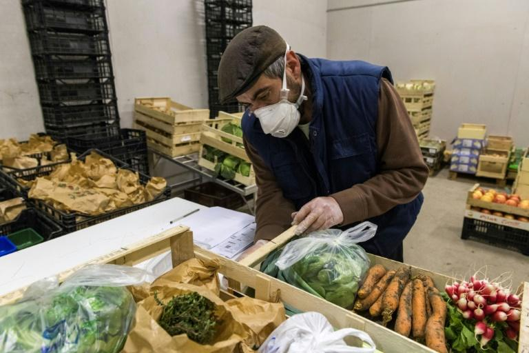 Some experts point to people who have panic-bought a cupboard full of fresh food, finding themselves duty-bound to eat their way through it (AFP Photo/Thierry ZOCCOLAN)