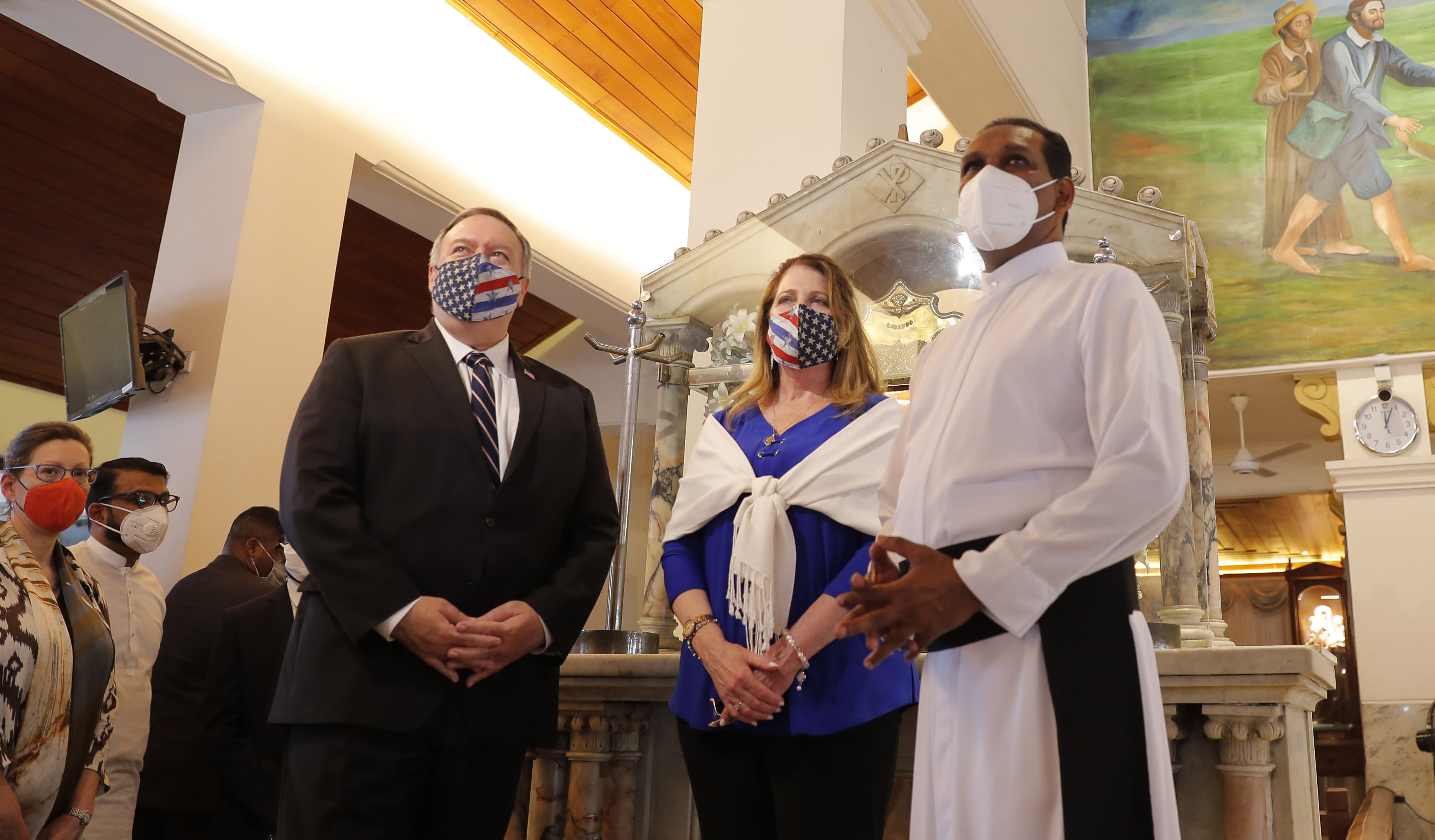 U.S. Secretary of State Mike Pompeo and his wife Susan visit St. Anthony's church, one of the sites of the 2019 Easter Sunday attacks, in Colombo, Sri Lanka, Wednesday, Oct. 28, 2020. Pompeo plans to press Sri Lanka to push back against Chinese assertiveness, which U.S. officials complain is highlighted by predatory lending and development projects that benefit China more than the presumed recipients. The Chinese Embassy in Sri Lanka denounced Pompeo's visit to the island even before he arrived there, denouncing a senior U.S. official's warning that the country should be wary of Chinese investment. (AP Photo/Eranga Jayawardena, Pool)