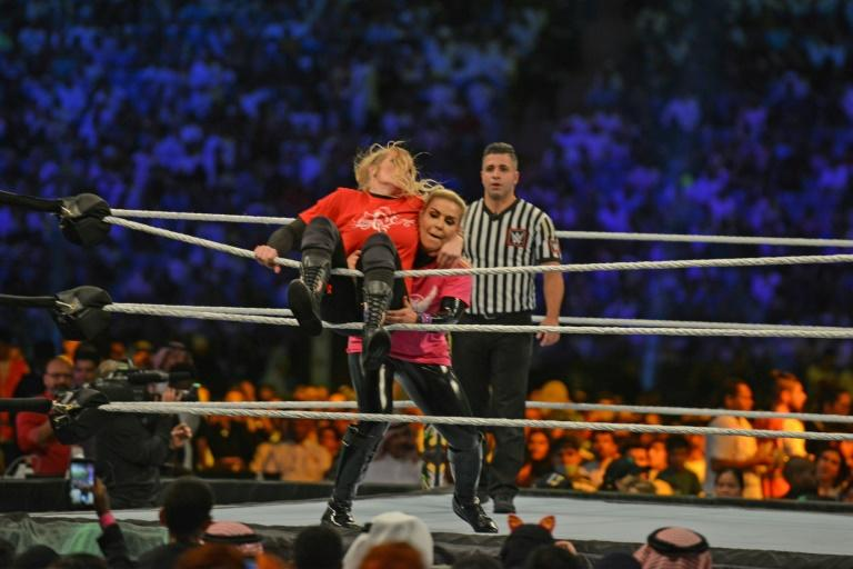 Lacey Evans (red) fights against Natalya in Saudi Arabia's first ever wrestling match in October (AFP Photo/Fayez Nureldine)