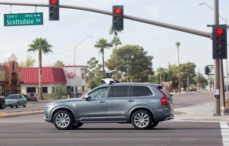A self driving Volvo vehicle, purchased by Uber, moves through an intersection in Scottsdale