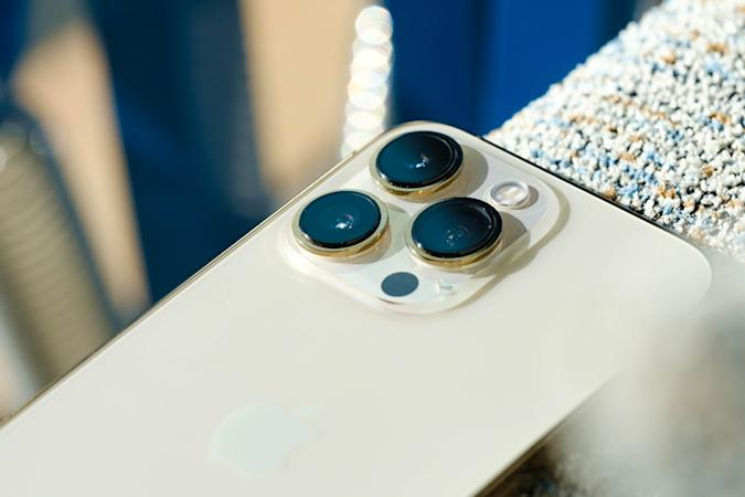 Apple iPhone 13 Pro in gold — back view