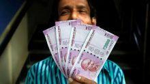 Rupee slips 16 paise to 69.05 against dollar; Sensex, Nifty down 0.70% each