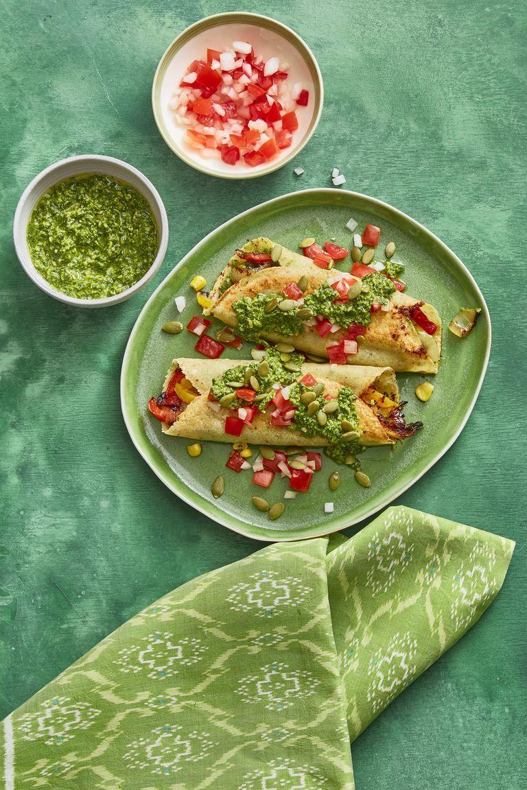 """<p>The best part of these enchiladas is the mouthwatering salsa, made with cilantro, jalapeño, sugar, lime juice, and pumpkin seeds. </p><p><a href=""""https://www.womansday.com/food-recipes/food-drinks/recipes/a60792/enchiladas-with-pumpkin-seed-salsa-recipe/"""" rel=""""nofollow noopener"""" target=""""_blank"""" data-ylk=""""slk:Get the Enchiladas with Pumpkin Seed Salsa recipe."""" class=""""link rapid-noclick-resp""""><em>Get the Enchiladas with Pumpkin Seed Salsa recipe.</em></a></p>"""
