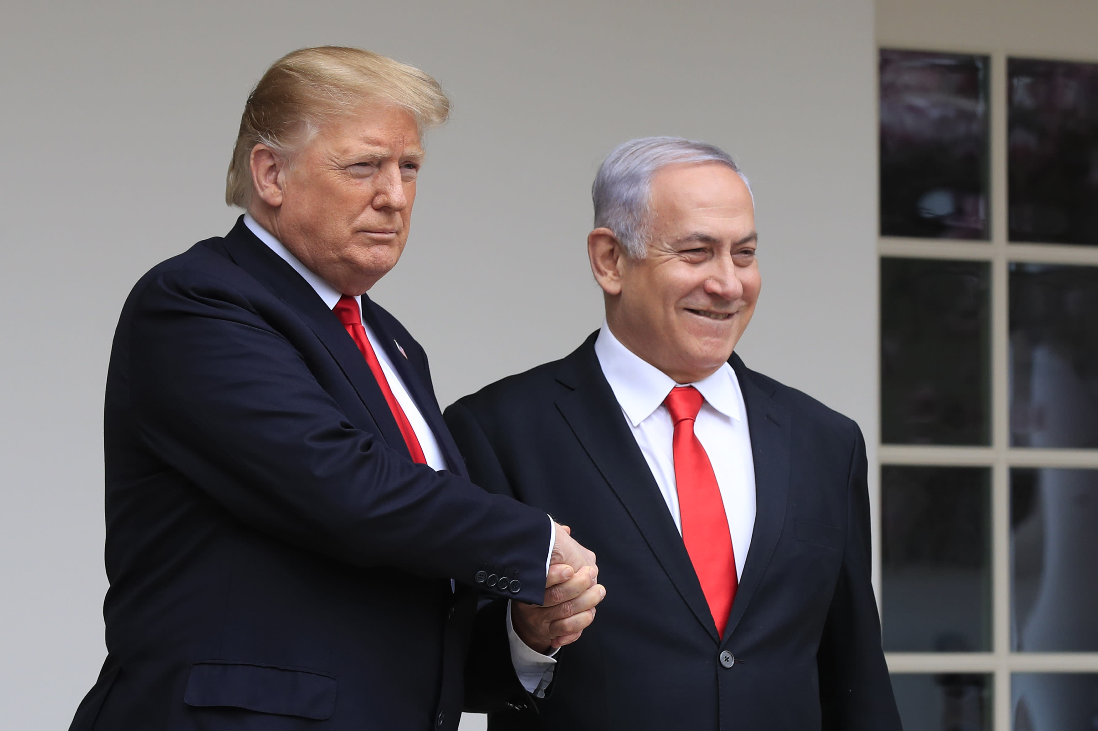 FILE - In this March 25, 2019 file photo, President Donald Trump welcomes visiting Israeli Prime Minister Benjamin Netanyahu to the White House in Washington. In the eyes of critics, Benjamin Netanyahu's decision to bar two Democratic congresswomen at the request of President Donald Trump is the latest reckless gamble by a prime minister willing to sacrifice Israel's national interests for short-term gain. And yet the pursuit of such allegedly short-term gains has kept Netanyahu in power for more than a decade. (AP Photo/Manuel Balce Ceneta, File)