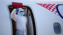 Global virus deaths top 60,000, Trump warns of 'tough week' ahead