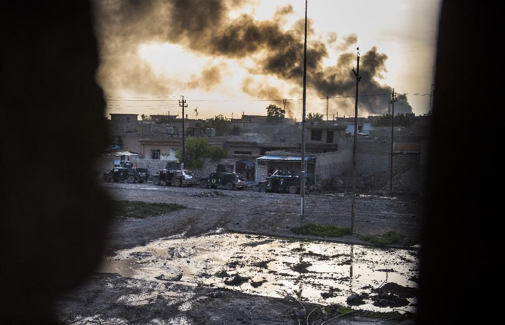 Smoke billows from Islamic State positions during fighting in the eastern Samah area of Mosul on November 11, 2016 (AFP Photo/Odd Andersen)