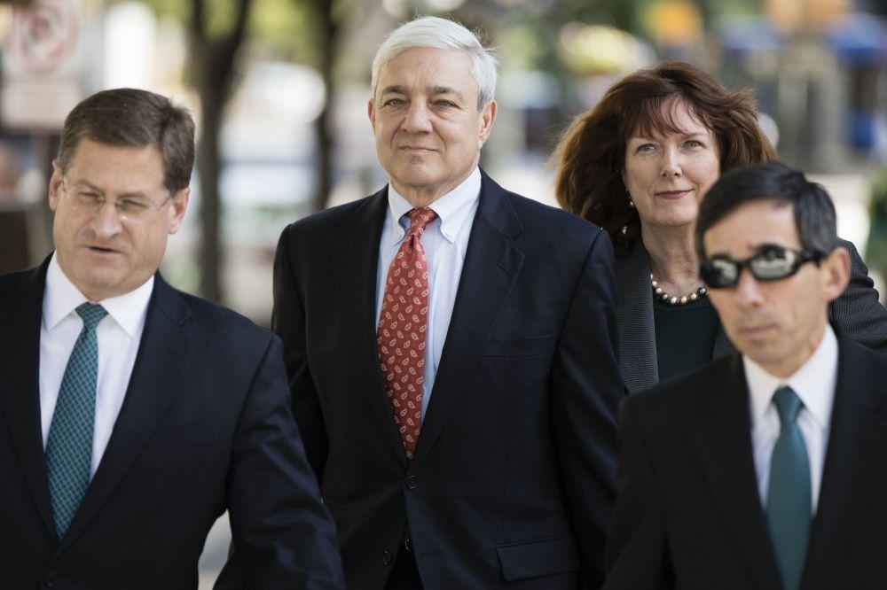 Former Penn State president Graham Spanier (center) arrives for his sentencing hearing. (AP)