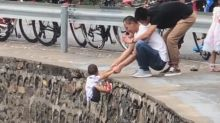'Thoughtless idiots': Video shows dad dangling son over cliff for photo