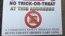 Police hang 'no trick-or-treat' signs at the homes of registered sex offenders