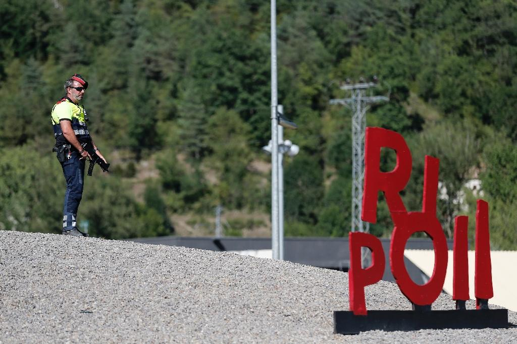 A Police officer stands guard at a blocked road near Ripoll after last year's attack (AFP Photo/PAU BARRENA)