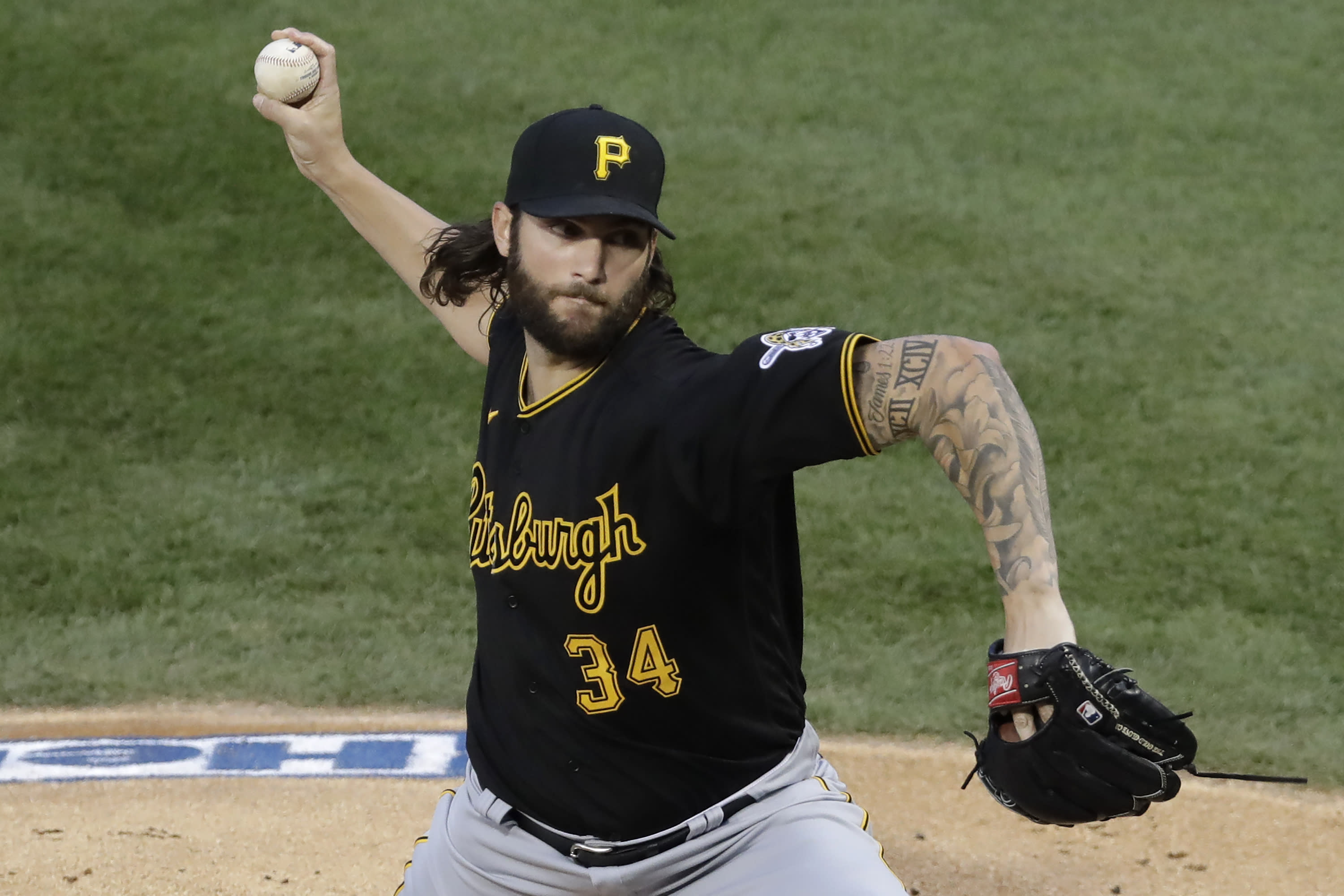 Pittsburgh Pirates starting pitcher Trevor Williams throws against the Chicago Cubs during the first inning of a baseball game in Chicago, Friday, July 31, 2020. (AP Photo/Nam Y. Huh)