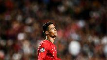 Ronaldo injured as Portugal held by Serbia