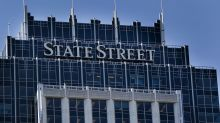 State Street stock falls most in two years after halting buyback to complete merger