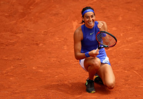 Caroline Garcia smiles after earning a spot in the Round of 16 at the French Open. (Getty Images)