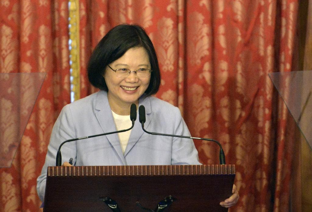 Donald Trump took a congratulatory phone call from Taiwanese President Tsai Ing-wen, a move that upended nearly 40 years of diplomatic protocol and raised questions about whether the US president-elect intends to pursue a hard line against Beijing (AFP Photo/SAM YEH)