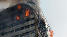 Many Iran firefighters feared trapped in building collapse