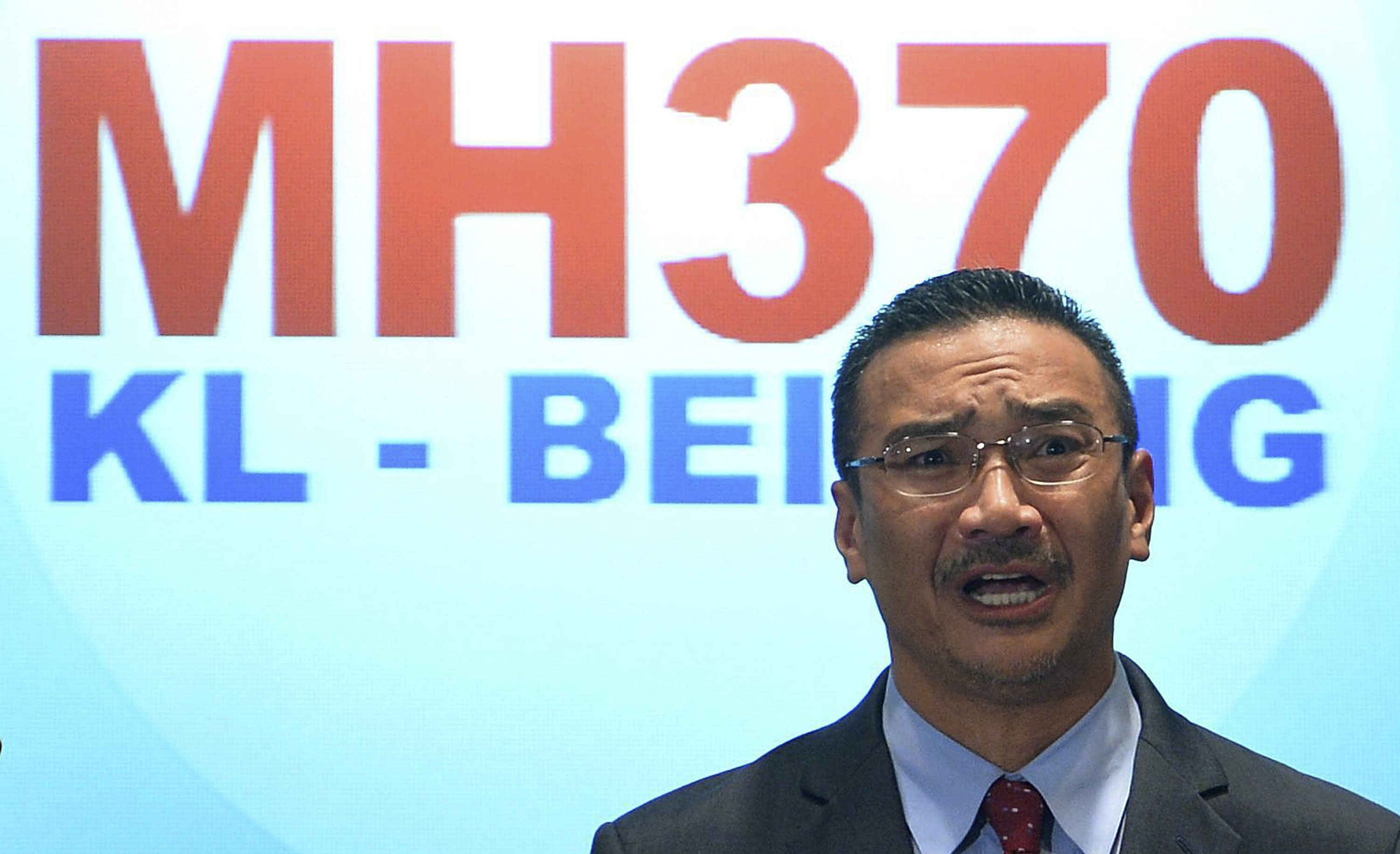 """Malaysian acting Transport Minister Hishammuddin Hussein speaks during a press conference at a hotel in Sepang, Malaysia, Thursday, March 20, 2014. Military search planes flew over a remote part of the Indian Ocean on Thursday hunting for debris in """"probably the best lead"""" so far in finding the missing Malaysia Airlines flight, officials said. (AP Photo) MALAYSIA OUT"""