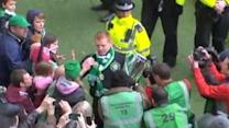 Neil Lennon gives winner's medal to young fan