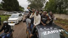 Giddy Zimbabweans gather in capital to march against Mugabe