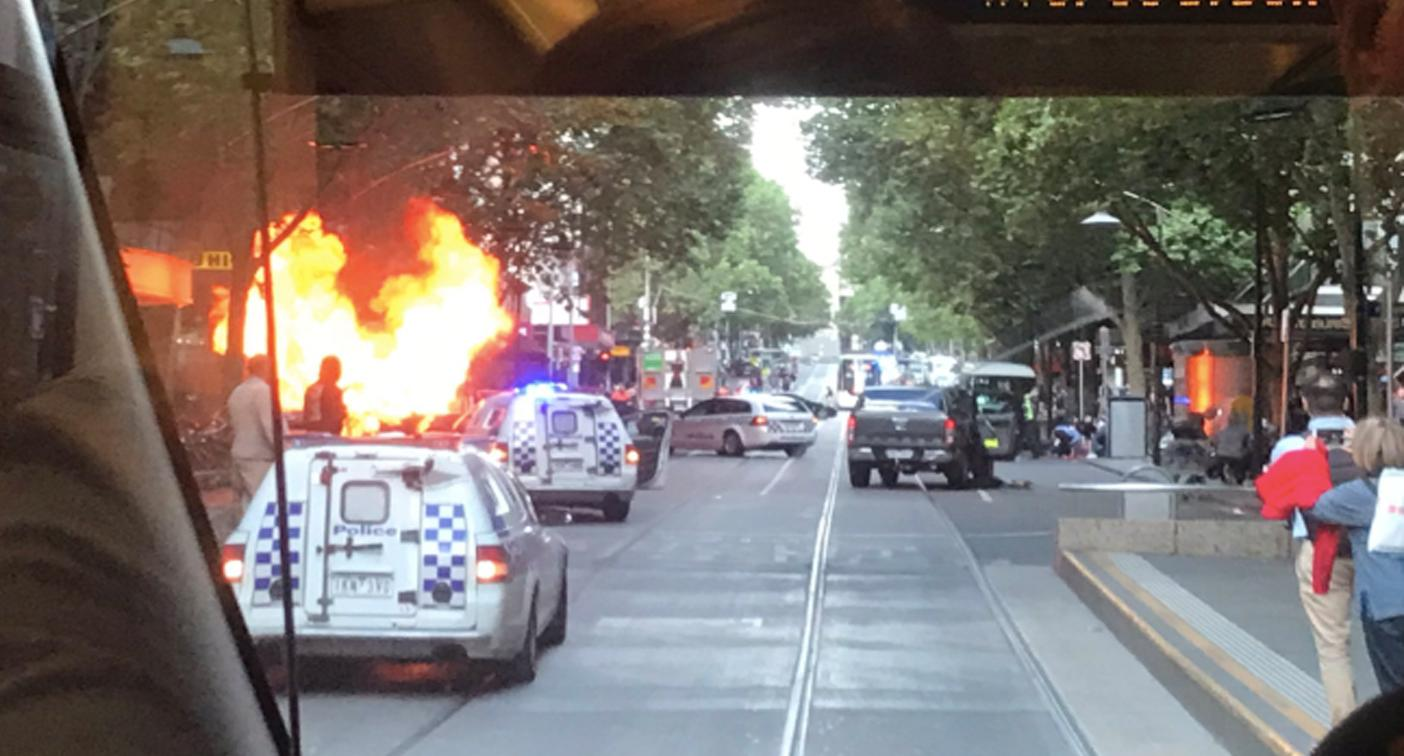 Knife-wielding man attacks police, car bursts into flames in Bourke St, Melbourne chaos