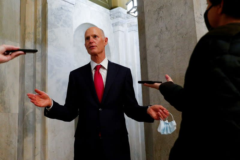 FILE PHOTO: Senator Rick Scott (R-FL) speaks to news reporters after departing from the Senate Floor, as the coronavirus disease (COVID-19) outbreak continues in Washington