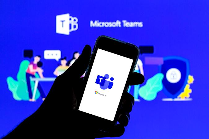 SPAIN - 2021/04/20: In this photo illustration a Microsoft Teams app seen displayed on a smartphone with the Microsoft Teams logo in the background. (Photo Illustration by Thiago Prudencio/SOPA Images/LightRocket via Getty Images)