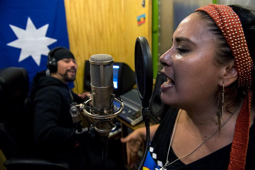 Filutraru Paillafilu (L) and Ana Millaleo, members of the Wechekeche Ni Trawun rap group, rehearse in Santiago (AFP Photo/Martin BERNETTI)