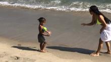 Beach Ball! Watch Kim Kardashian Frolic with Her Kids on the Sand in a Neon Bikini