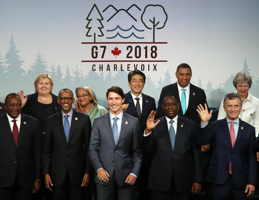 (Front row L-R) Kenyan President Uhuru Kenyatta, Rwandan President Paul Kagame, Canadian Prime Minister Justin Trudeau, Senegalese President Macky Sall, Argentinean President Mauricio Macri, (back row L-R), Norwegian Prime Minister Erna Solberg, Bangladeshi Prime Minister Sheikh Hasina, Japanese Prime Minister Shinzo Abe, Jamaican Prime Minister Andrew Holness, and British Prime Minister Theresa May in a family photo of the G7 Outreach during the G7 summit in Canada