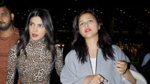 Pics: A glowing Priyanka returns to India to prepare for wedding; Parineeti is by her side