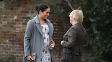 Meghan Markle steps out in figure-hugging maternity dress, admits to feeling 'very pregnant'