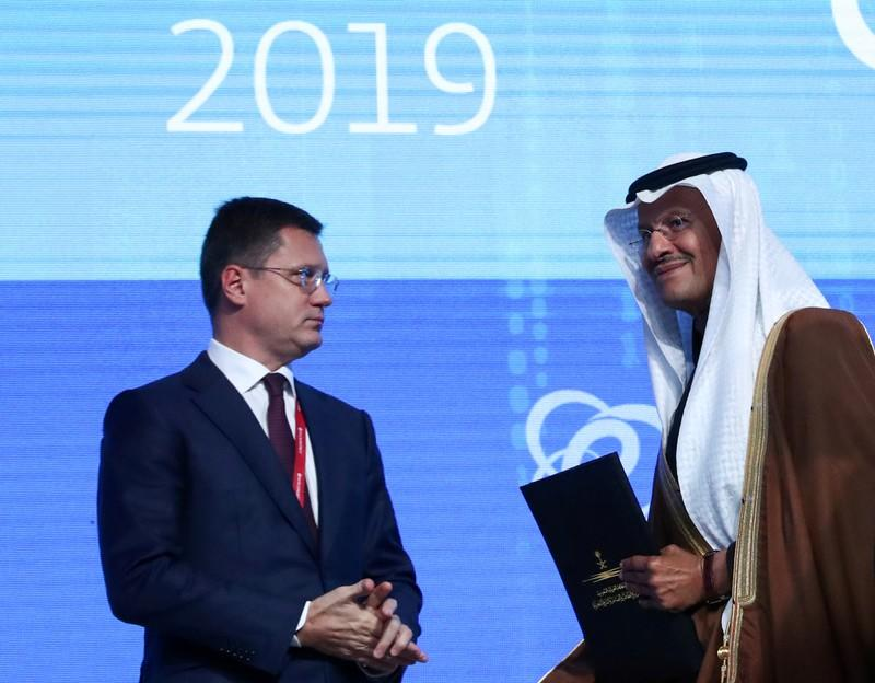 FILE PHOTO: Saudi Energy Minister Bin Salman and Russian Energy Minister Novak attend the Energy Week International Forum in Moscow