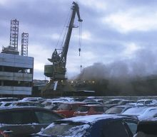 Fire on Russia's only aircraft carrier kills 1, injures 11