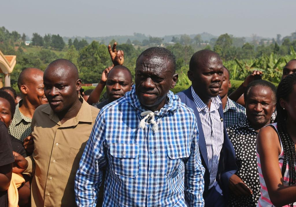 Kizza Besigye (centre) rejected President Yoweri Museveni's February 18 election victory, alleging fraud