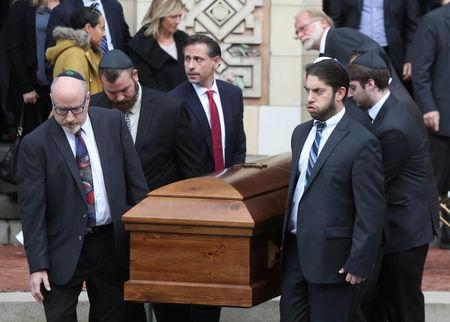 A casket is carried from Rodef Shalom Temple after funeral services for brothers Cecil and David Rosenthal, victims of the Tree of Life Synagogue shooting, in Pittsburgh, Pennsylvania, U.S., October 30, 2018. REUTERS/Cathal McNaughton