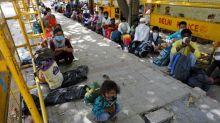 India coronavirus cases rise as millions return home