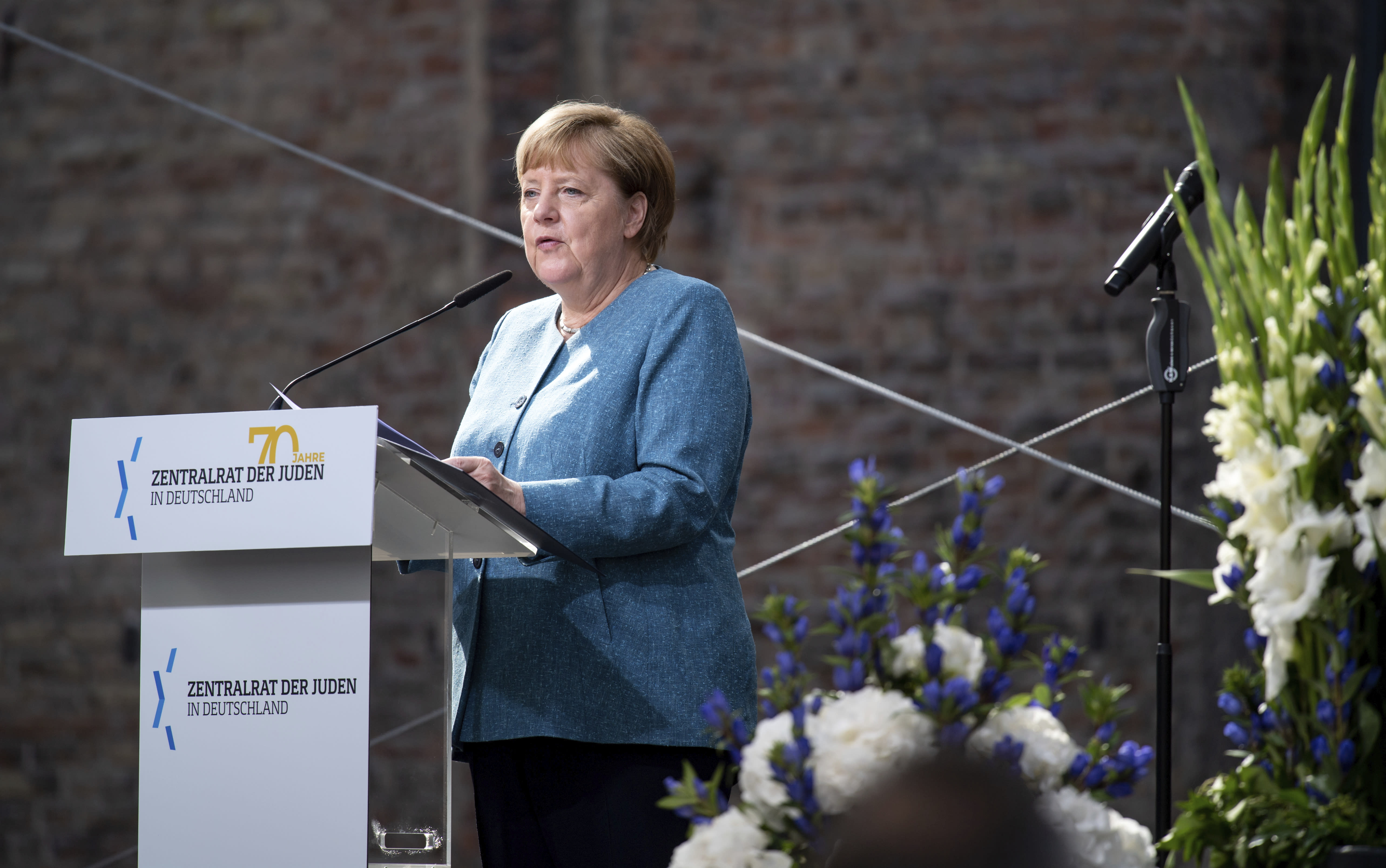 Chancellor Angela Merkel speaks at the ceremony to mark the 70th anniversary of the Central Council of Jews in the courtyard of the New Synagogue in Berlin, Germany, Tuesday, Sept. 15, 2020. The Central Council of Jews in Germany was founded on 19 July 1950 in Frankfurt am Main. (Bernd von Jutrczenka/Pool via AP)