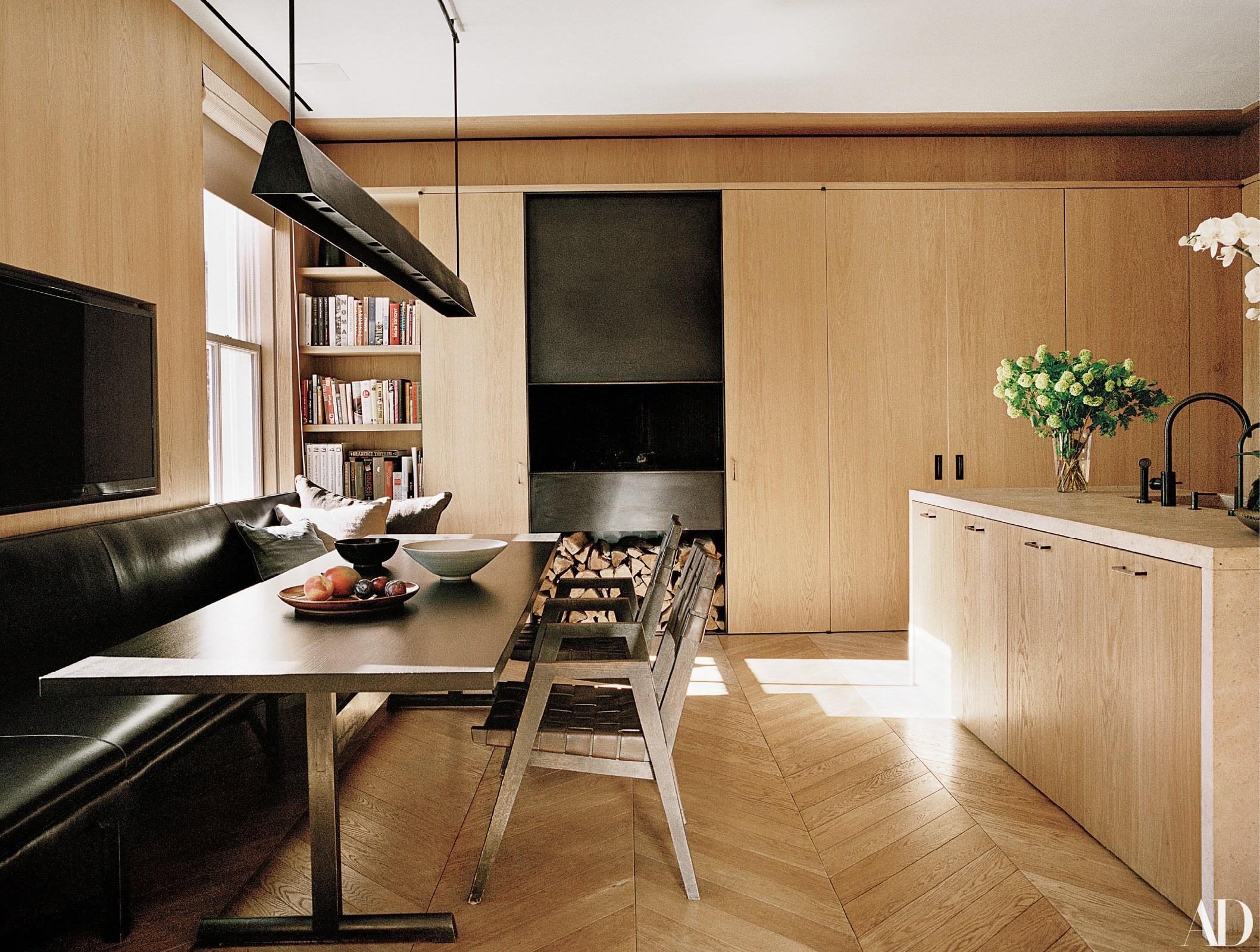Van Duysen designed the kitchen's pendant light, oak cabinets, table, chairs, and island.