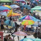 Beach and party crowds across US break social distancing rules over Memorial Day weekend